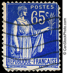 Stamp printed in France shows a woman with Olive Branch