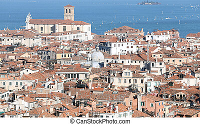 Venice, Italy, red-tiled roofs of the houses and the Church...