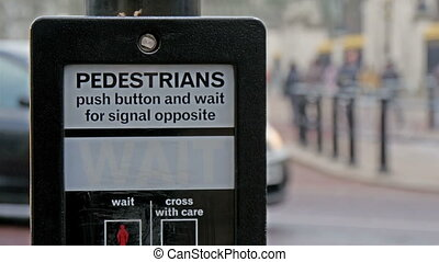 Its a go signal for pedestrian in London street. The signage...