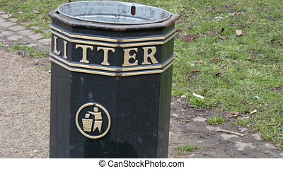 A black litter can in the Royal Park This is for people to...