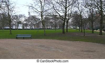 People walking by the Green Park in London. Early morning...