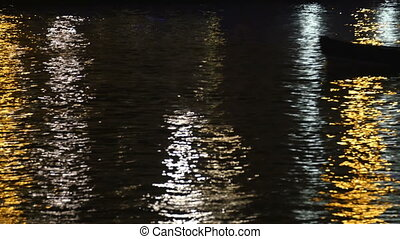 The Thames river in London where a boat is crossing. Showing...