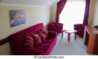 The room in the hotel - Large room with a sofa, an armchair,...