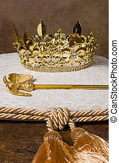 Royal crown on cushion - Royal scepter and golden crown on a...