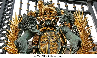 Closer look of the carved unicors and lions on the gate of...