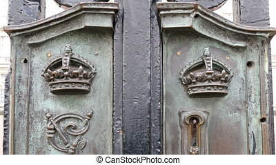 The metal gate and the carvings on it in Buckingham Palace...