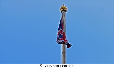 The flag pole with the golden crown in Buckingham Palace...
