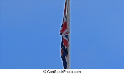 The flag pole on the roof of the Buckingham Palace. Seen are...