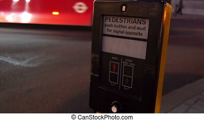 Pedestrian signboard on the sidewalk in London. People have...