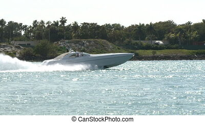 Luxury speedboat cruising down a canal in Miami