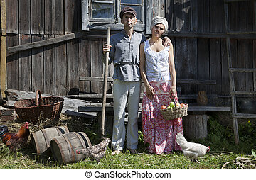 Retro couple on a farm - Couple in a stiff, old classic...