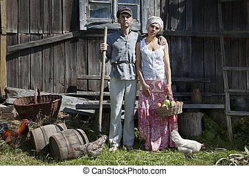 Retro couple on a farm - Couple in a stiff, old classic...