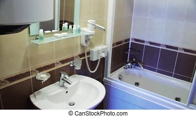 Bathroom in the hotel - Bathroom with wash basin, toilet and...