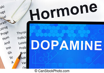 Tablet with Dopamine - Papers with hormones list and tablet...