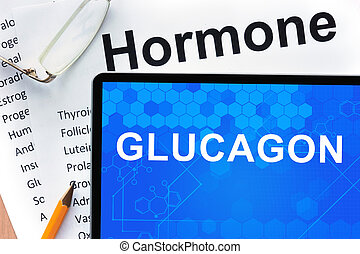 Tablet with Glucagon - Papers with hormones list and tablet...