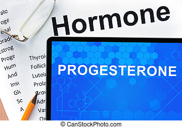 progesterone - Papers with hormones list and tablet with...
