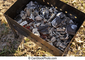 charcoal preparation for bbq in mangal, outdoor picnic