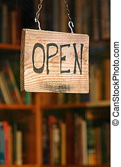 Book store - An open sign on the door of a used book store...