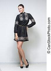sexy woman in black dress. long legs