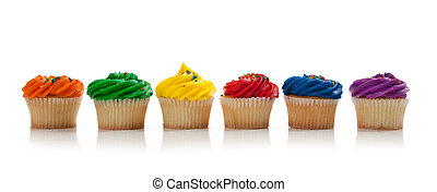 Assorted colored Cupcakes with sprinkles on white - A red,...