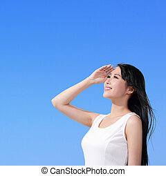 Beautiful woman with blue sky