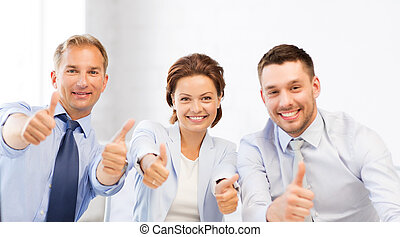 business team showing thumbs up in office - friendly...