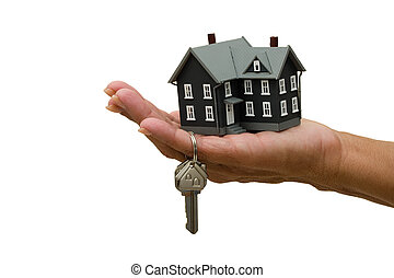 Unlocking Your Door - A house key in a person�s hand...