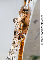 Rope tied onto rusty shackle - Hemp rope tied onto a rusty...