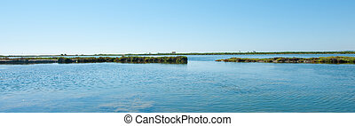 Estuary - Panoramic view of an estuary with water and...