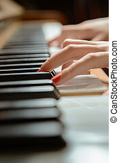 Female piano player - Female hands playing the piano