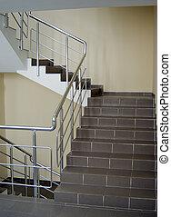 enclosure - stairway enclosure with metallic stair railing...