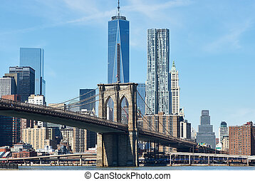 Brooklyn Bridge with lower Manhattan skyline in New York...