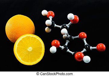 Orange and vitamin C structure model Ascorbic acid on black...