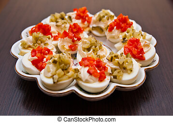 eggs with cucmber and red pepper with mayonnaise on the...