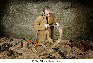 manual worker - fine portrait of craftsman at work with...
