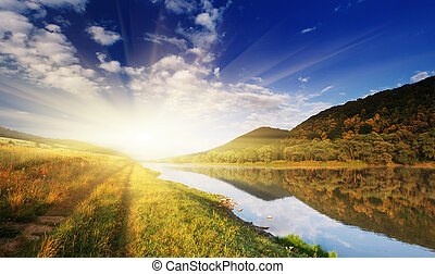 summer landscape - Beautiful summer sunset in the river. HDR...