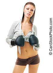 Young beautiful confident woman in boxing gloves, front...