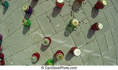 Set of memorial candles - On granite wall are rows of...