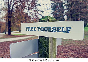 Rustic signboard outdoors in an autumn park with words Free...