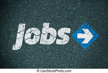 Jobs direction - Road surface with the word jobs written on...