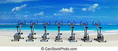 Spinning class in paradise - Exercise bikes on a beautiful...