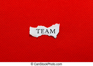 Team - A scrap of paper with the word team