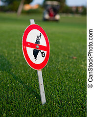 Forbidden sign post with golf bag - Sign forbidding the...