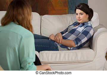Girl at psychologist - Young pretty troubled girl at...
