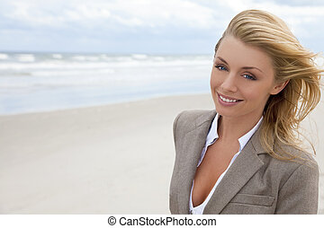 Beautiful Blond Woman At the Beach - A beautiful blond young...