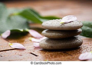 Wellness - Stones with flower petals and water drops