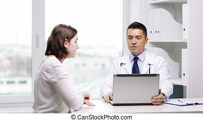 doctor and young woman meeting at hospital - medicine,...