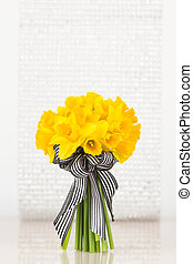 Vivid yellow daffodil bouquet - Yellow daffodils tied with...