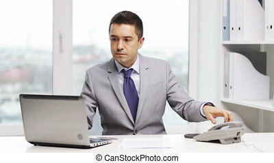 businessman with laptop calling on phone - business, people,...