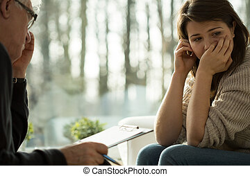 Depressed woman - Young depressed woman taking advice from...